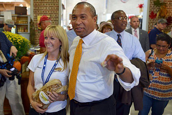 Gov. Deval Patrick makes a stop at the Pittsfield Rye booth and talks with Renee Robbins on Massachusetts Day at the Big E.